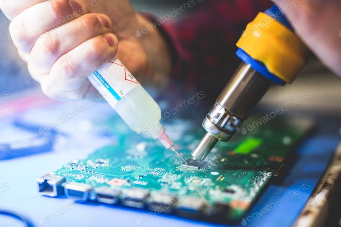 Man fixing electronic board