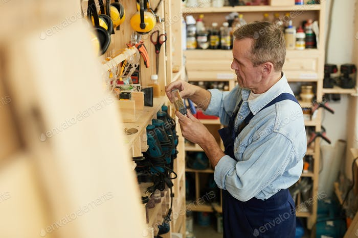 Senior Worker Choosing Tools