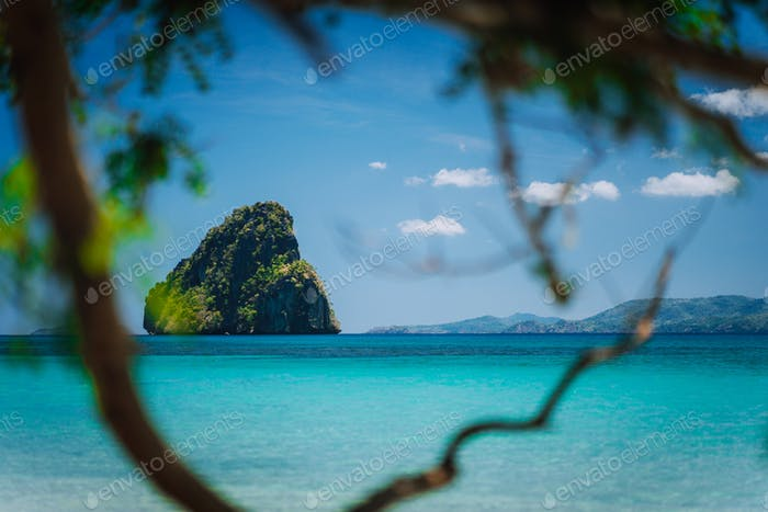 El Nido, Palawan, Philippines Journey. Tropical beach scenery with rocky island in open ocean framed