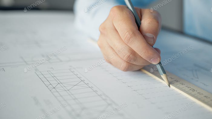 Male hands drawing a design
