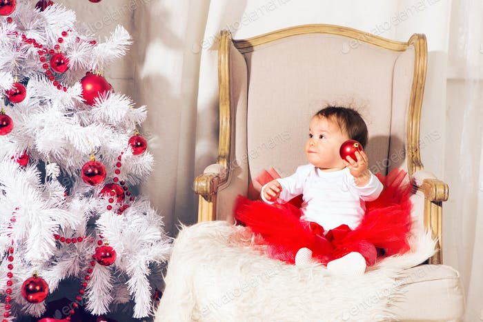 happy baby child girl near a Christmas tree