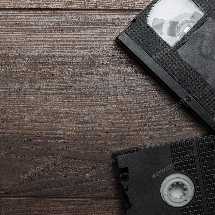 Old Retro Video Tapes On Wooden Background