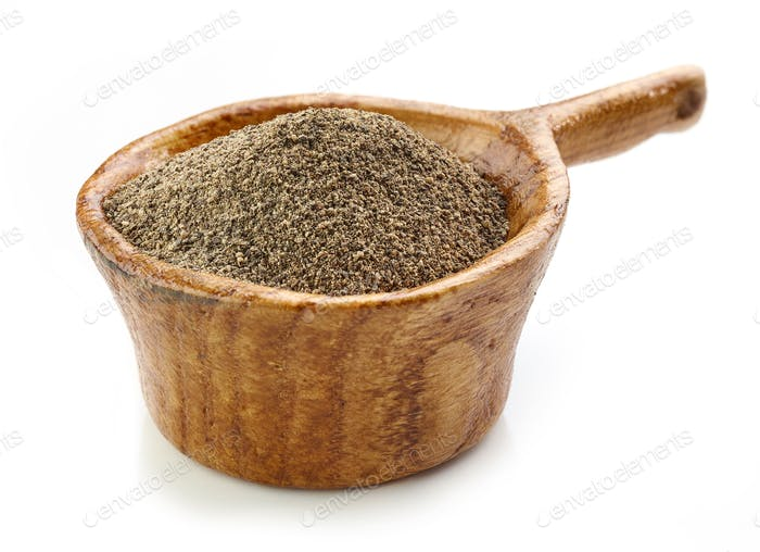 black pepper in wooden cup