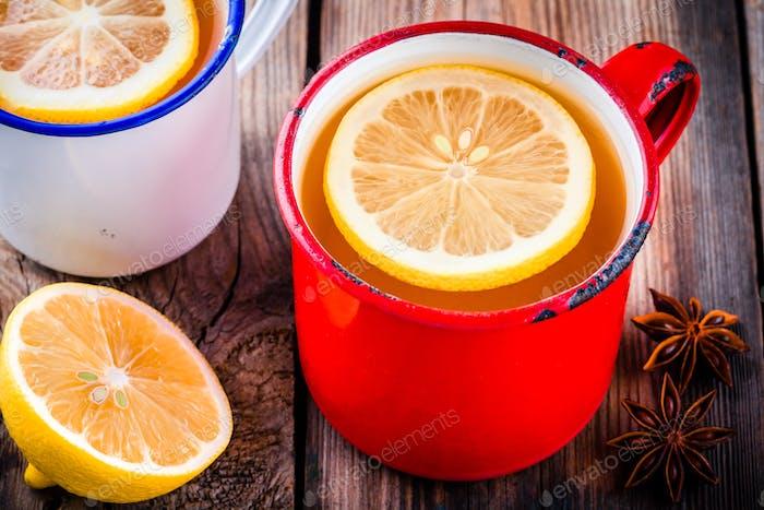 Hot tea with lemon in a rustic mug