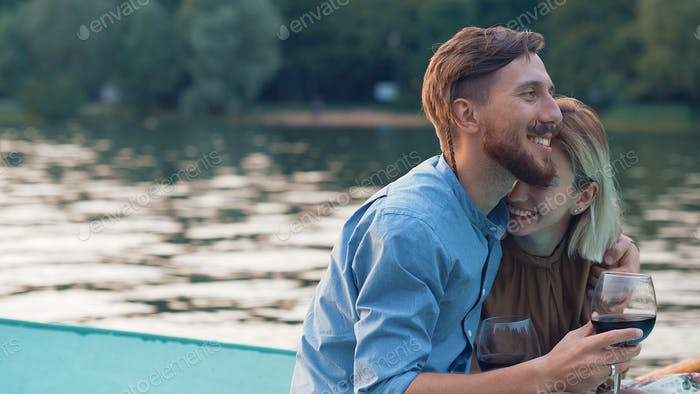 Happy couple in a boat