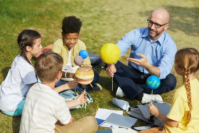 Group of Kids Enjoying Astronomy Lesson Outdoors