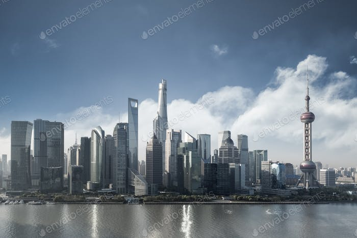 shanghai cityscape in morning, financial center buildings closeup with blue sky