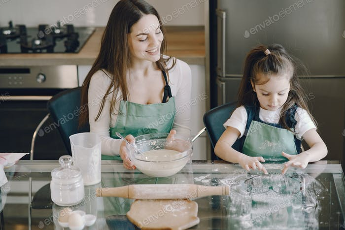Family cook the dough for cookies