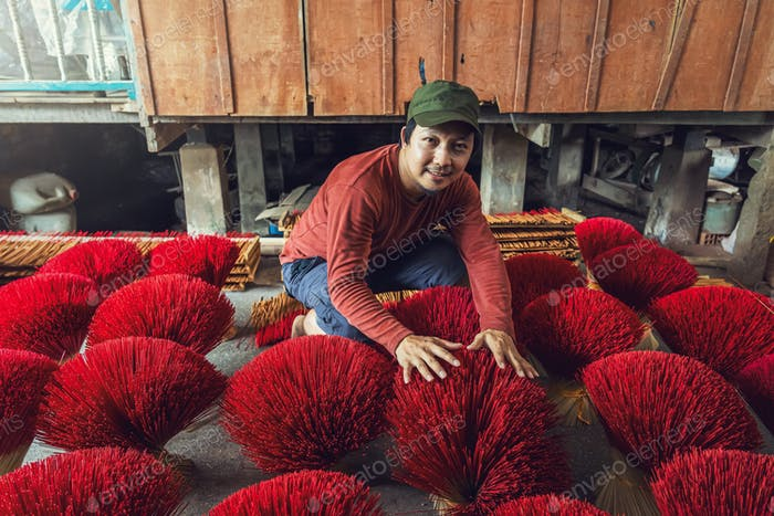 Asian traveler male making the traditional vietnam red insense in old traditional house