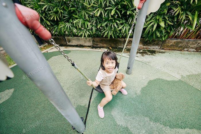 Mixed-race swinging girl