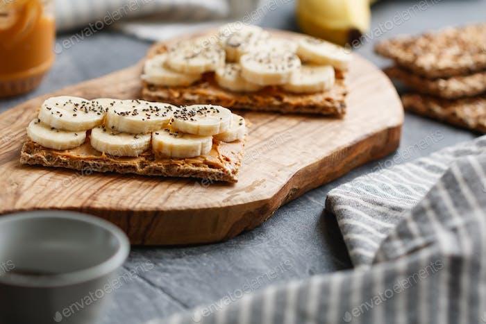 Two multi grain breads with peanut paste
