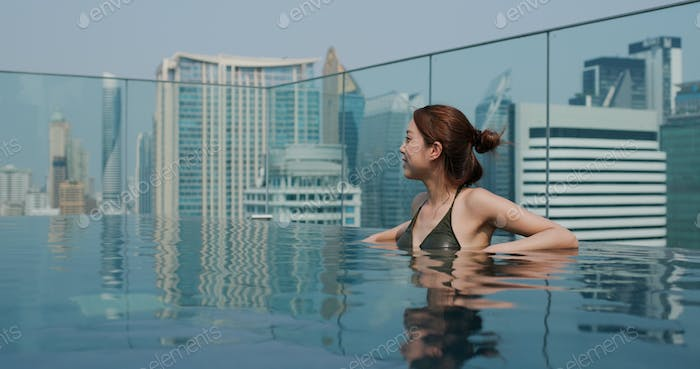 Woman enjoy at swimming pool