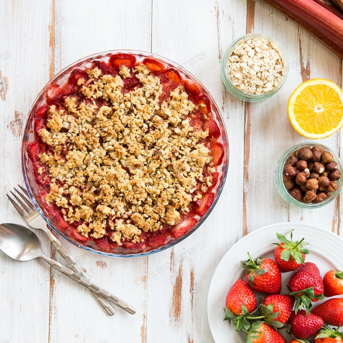 Rhubarb and Strawberry crumble with all ingredients nearby