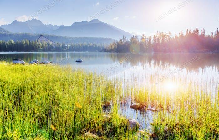 Majestic mountain lake in National Park High Tatra. Strbske pleso, Slovakia