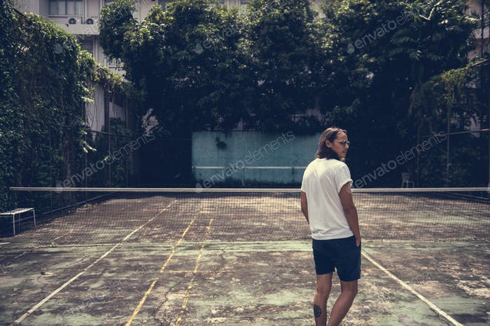 Man standing in a tennis court