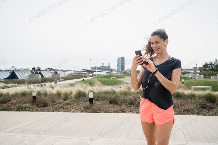 Athletic woman using her phone.