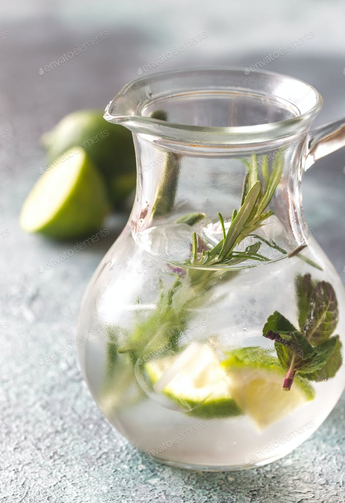 Glass of lime water with herbs