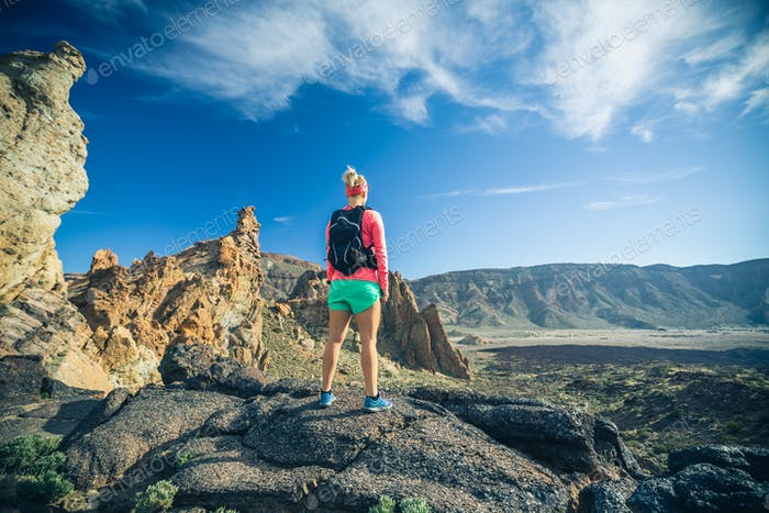 Woman hiker reached mountain top, backpacker adventure