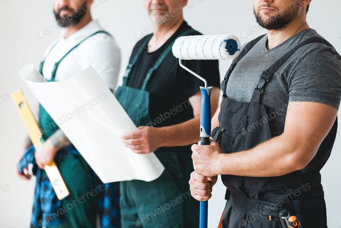 Close up of crew of three professional builders