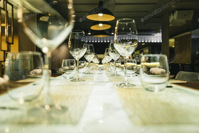 Wine glasses on a table in a restaurant