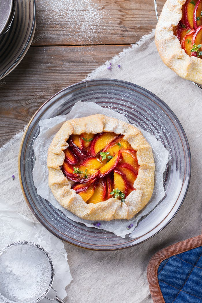 Homemade seasonal summer fruit galette, tart, pie with nectarines, peaches