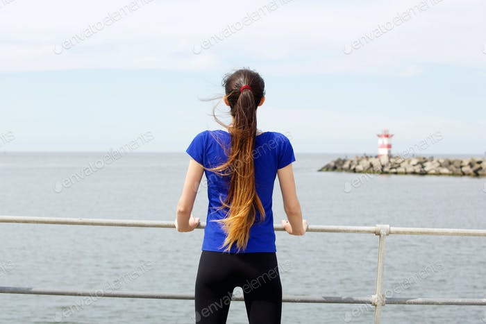 Portrait of sporty woman from behind