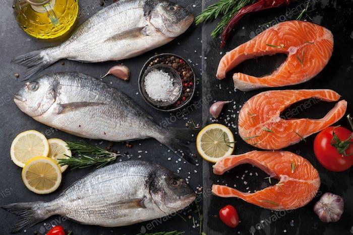 Raw salmon and dorado fish fillet