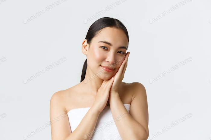 Beauty, personal care, spa salon and skincare concept. Tender beautiful asian girl in bath towel