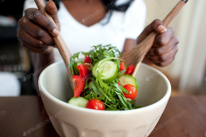 Ethnic woman preparing a salad