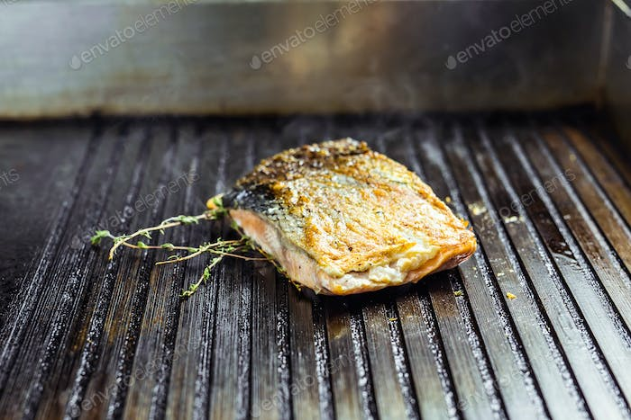 salmon roasted close up on home electronic grill plate tasty diet fish meal