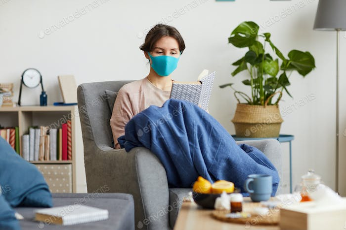 Woman sitting at home she is ill