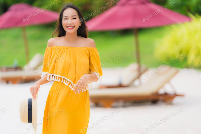 Portrait beautiful asian woman wear hat with smile happy leisure