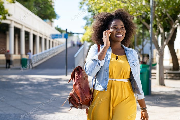 African woman talking on phone