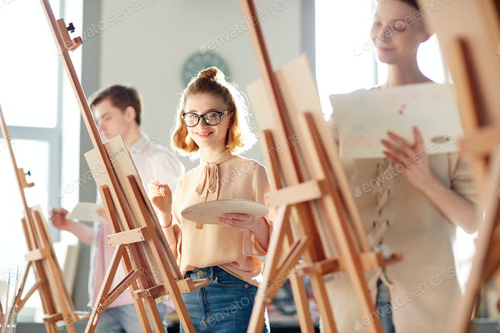 Girl at painting lesson