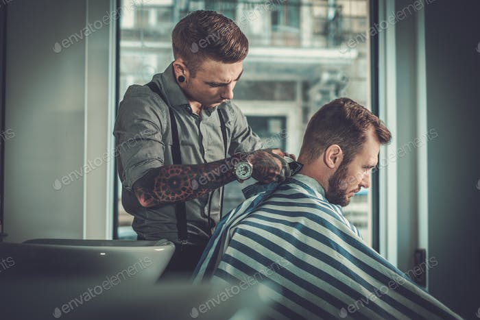 Confident man visiting hairstylist in barber shop.