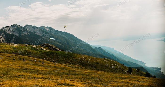 Paraglider on Mote Baldo andl ake Garda in Italy