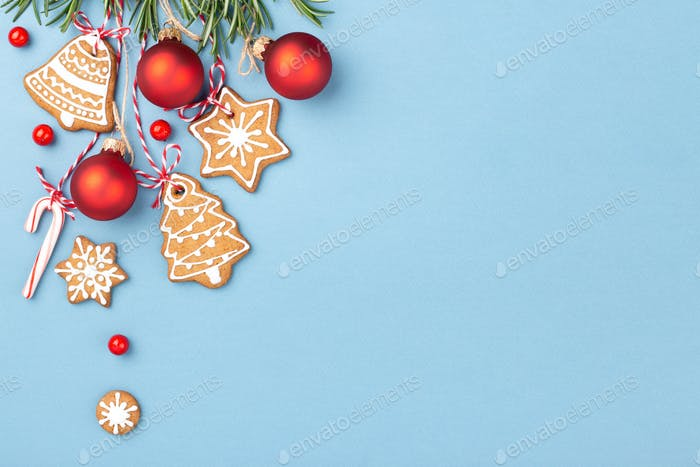 Christmas Gingerbread Cookies and Red Balls with Paper Tag on Blue Background.