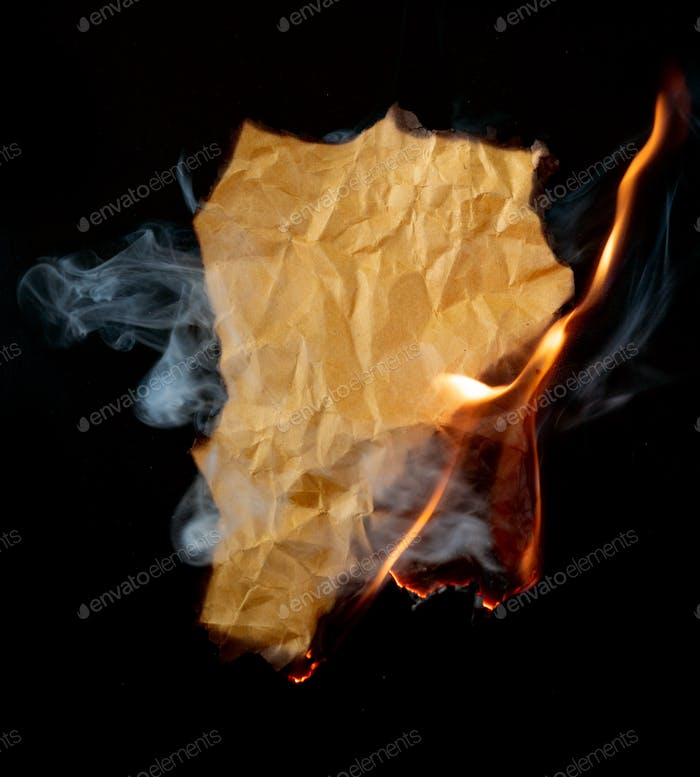 burning piece of crumpled paper