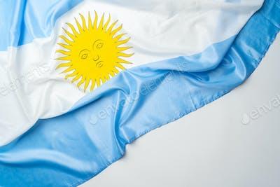 Photo of waving flag of Argentina lying on surface