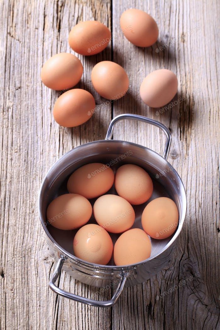 Brown eggs in a pan