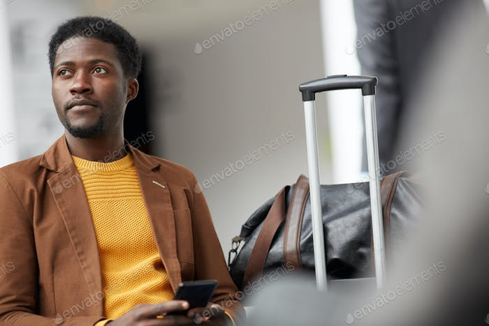 Black man waiting for his airplane