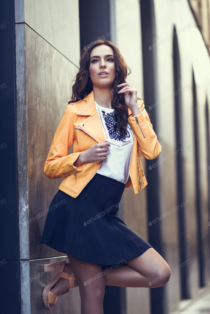 Young brunette woman in urban background