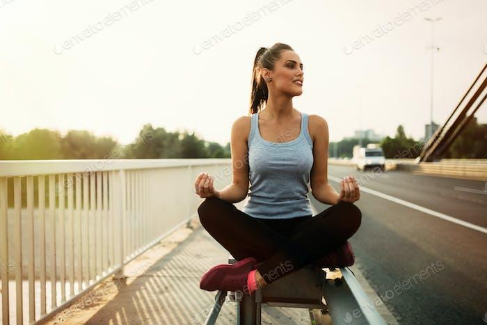 Healthy woman in lotus posture