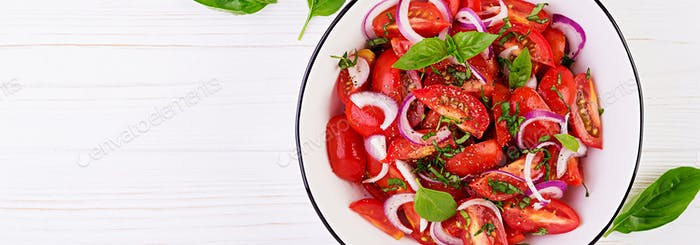 Tomato salad with basil and red onions. Homemade food.  Concept