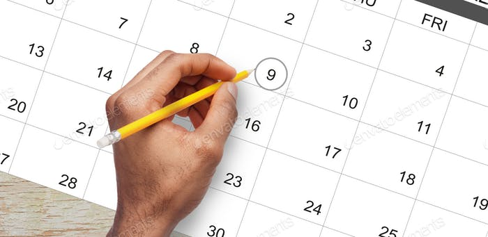 Male hand marking circle on calendar as a reminder about important day