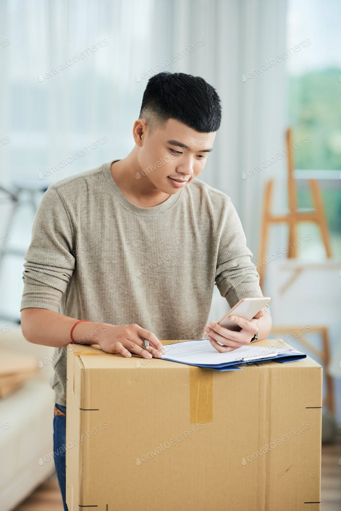 Man filling the form for delivery