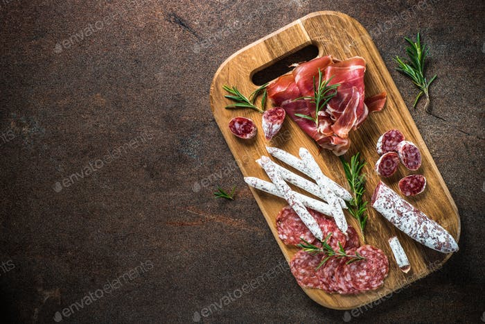 Antipasto - sliced meat, ham, salami, olives and wine  top vie