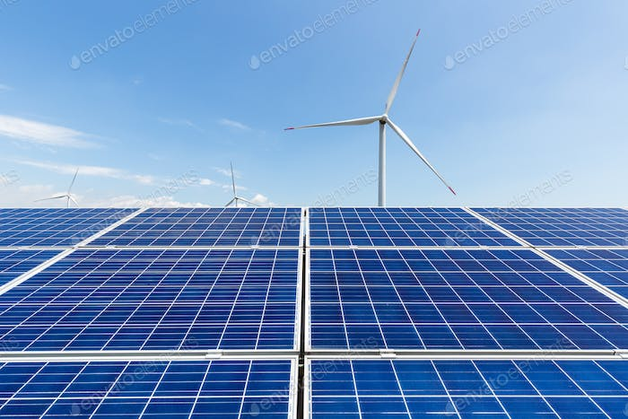 solar panel and wind turbine against a clear sky, clean energy landscape