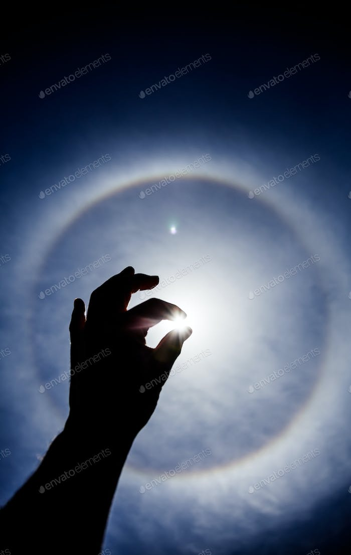 Hand silhouette with Circular Sun Halo
