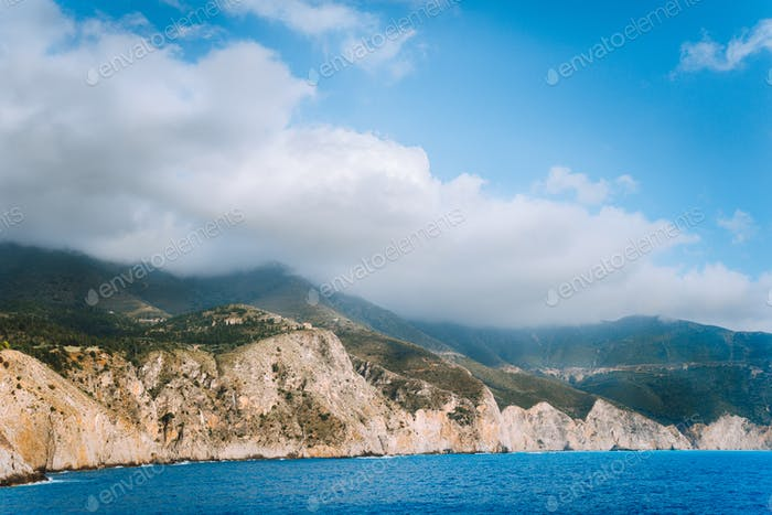 Picturesque rocky coastline on Kefalonia island. Amazing landscape in soft light with cloudscape